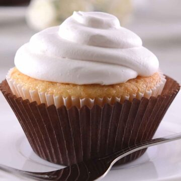 white frosting on cupcake